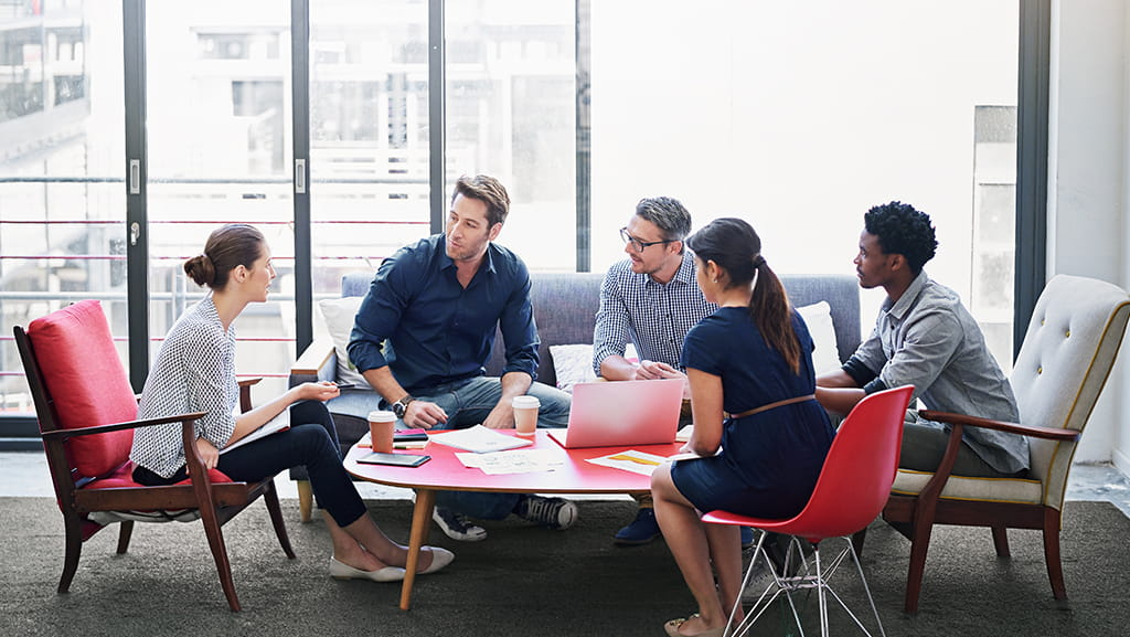 Employees engaged in active discussion